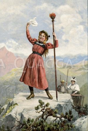 Junge Frau erreicht triumphierend die Bergspitze