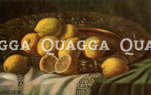 Zitronen auf einem Messing-Teller