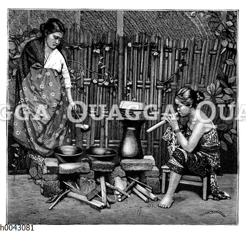 Javanische Frauen beim Reiskochen