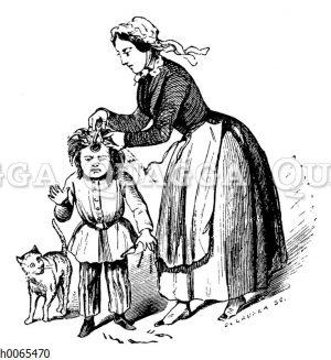 Frau schneidet Kind die Haare