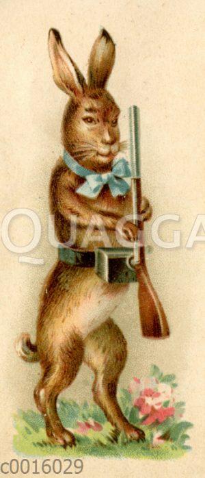 Osterhase als Soldat präsentiert das Gewehr