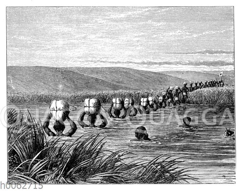 Träger überqueren einen Fluss in Afrika