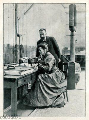 Marie Curie und Pierre Curie in ihrem Labor