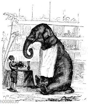 Dressierter Elefant mit Serviette und Dompteur