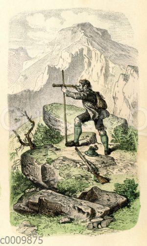 Jäger errichtet Gipfelkreuz