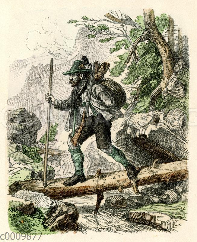 Jäger mit erbeuteter Gams überquert einen Bach in den Bergen