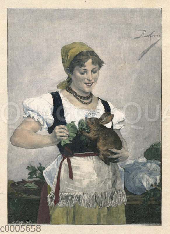 Mädchen füttert Kaninchen mit Salat