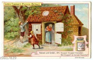 Hänsel und Gretel knuspern am Pfefferkuchenhaus