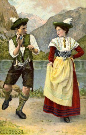 Mann und Frau beim Schuhplattler-Tanz